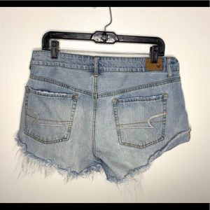 < American Eagle Distressed Denim Shorts >